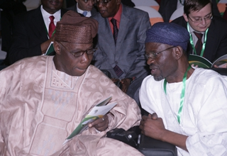 Former Nigeria President, Chief Olusegun Obasanjo with The Special Adviser to the President on NEPAD at the Business Forum
