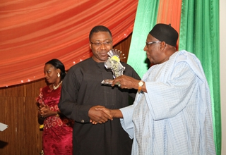 H.E. Dr. Bamangar Tukur recieving an African Achievement Award  .